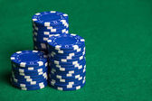 Blue poker chips on the green table — Fotografia Stock