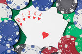 Poker cards with royal flush combination and chips on green tabl — Stock Photo
