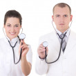 Young male and female doctors with stethoscopes isolated on whit — Stock Photo #38655657