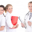 Stock Photo: Male doctor and two young nurses isolated on white