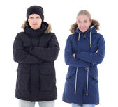 Attractive man and woman in winter clothes isolated on white — Stockfoto