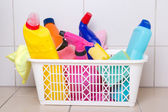 Cleaning supplies in plastic box on tiled floor — Stockfoto
