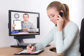 Businesswoman talking on the phone in bright office — 图库照片