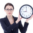 Young woman in business suit holding office clock isolated on wh — Stock Photo