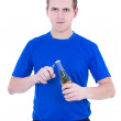 Young man opening the bottle of beer isolated on white — Stock Photo