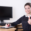 Beautiful business woman thumbs up in office and pc monitor with — Stock Photo