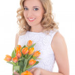 Beautiful woman with bouquet of orange tulips and jewelry gift b — Stock Photo
