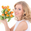 Young beautiful happy woman with orange tulips isolated on white — Stock Photo #41602897