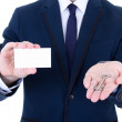 Close up of key and visiting card in male real estate agent hand — Stock Photo
