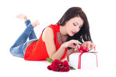 Young beautiful woman opening gift box isolated on white — 图库照片