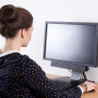 Back view of young beautiful business woman working in office wi — Stock Photo