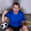 Funny man watching football on tv and celebrating goal — 图库照片