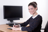 Beautiful business woman working in office and computer with bla — Foto de Stock