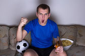 Funny man watching football on tv and celebrating goal — Stock Photo