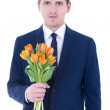 Young man holding bunch of tulips isolated on white — Stock Photo
