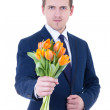 Happy mother's day - young man with bunch of tulips in hands iso — Stock Photo