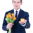 Proposal - young man in suit holding gift box with wedding ring — Стоковое фото