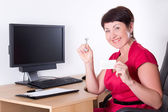 Middle aged estate agent sitting in office — Stock Photo