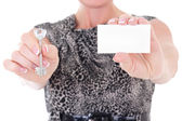 Key and visiting card in female hands — Stock Photo