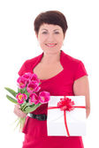 Woman with flowers and gift box isolated on white — ストック写真