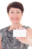 Beautiful middle aged businesswoman holding visiting card — Stock Photo