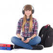 Cute teenage girl sitting and listening music — Stock Photo #45564625
