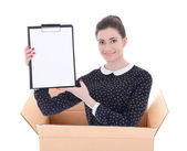 Delivery - woman in cardboard box holding blank clipboard isolat — Foto Stock