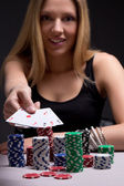 Young woman in casino with four aces in hand — Stock Photo