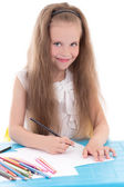 Funny little girl drawing using color pencils isolated on white — ストック写真