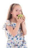 Beautiful little girl biting apple isolated on white — ストック写真