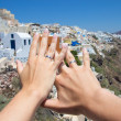 Honeymoon on Santorini island - hands with wedding rings over pa — Stock Photo #51325869