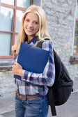 Portrait of female student at the college campus — Stockfoto