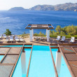 Luxurious swimming pool on seacost of Crete island — Stock Photo #51642647