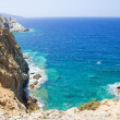 Rocky cliff and transparent sea water on Crete island — Stock Photo #51642745