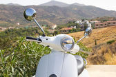 White retro scooter in mountains of Greece — Stock Photo