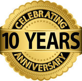 Celebrating 10 years anniversary golden label with ribbon, vector illustration — Vettoriale Stock