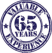 Valuable 65 years of experience rubber stamp, vector illustration — Stock Vector