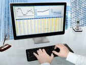 Analizing Data on Computer — Stock Photo