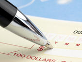 Pen on the Check — Stock Photo