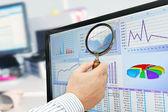 Analyzing Data on Computer — Stock Photo