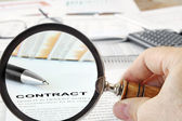 Magnifying Glass Over Contract Papers — Stockfoto