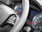 Close up of steering wheel commands — Stock Photo