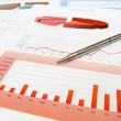 Pen on the investment chart — Stock Photo #5224490