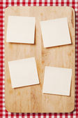 Stickers on wooden background — Stock Photo
