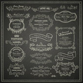 Set of vintage design elements on blackboard — Stock Vector