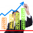 Businessman drawing graph grow — Stock Photo