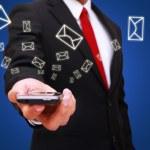 Businessman holding smart phone — Stock Photo