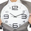 Stock Photo: Businessmshowing clock in suit