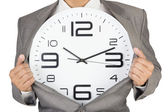 Businessman showing clock in suit — Stock Photo