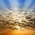 Sunbeam  through cloud blue and orange twilight sky — Stock Photo #43884721
